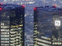 Cost cuts, lower legal expenses boost Deutsche Bank profit