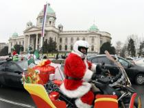 Motorcyclists dressed in costumes of Santa Claus