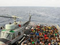 EU sources, readmissions of migrants condition for aid
