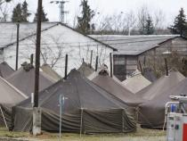 Macedonian police reopen border for a trickle of refugees