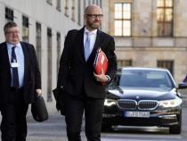 German coalition negotiator urges calmer approach